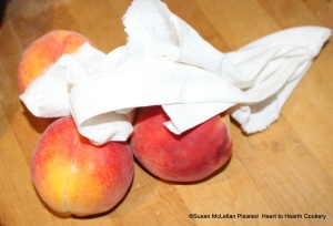 """Before placing the mellacattons (peaches) into the pie whole, the receipt (recipe) """"To bake Mellacattons"""" states to wipe them clean."""