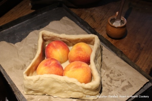 "After the coffin is made for the receipt (recipe) ""To bake Mellacattons"" fill the pie (with peaches) and put them in whole."