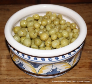 """A gally pot of gooseberries preserved in white wine and sugar, drained of their syrup and ready for the receipt (recipe) """"To bake preserved Gooseberries in pie"""""""