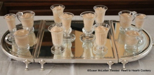"""The receipt (recipe) """"Quince Cream"""" made from mashed and sieved quince with sugar and egg whites was put in hand blown reproduction glasses and arranged on a mirrored plateau for serving."""