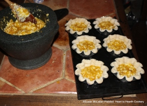 """After the orange-flower water is added and all mixed well together in the mortar and pestle to prepare the receipt (recipe) """" To make Orange Cheese Cakes"""" sheet your tins with puff-paste and half fill them."""