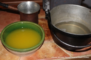 "After the grated rinds of two China oranges, two lemons and two Seville oranges has been strained from the Seville orange juice for the receipt (recipe) ""To make Orange Jelly"", mix the strained juice with the cooled isinglass dissolved in boiling water."