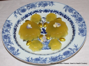 "This is the second presentation of the receipt (recipe) ""To make Orange Jelly"" from the pineapple and patty pan molds.  The jelly, made from the grated rinds of 2 China oranges, 2 lemons and 2 Seville oranges infused in Seville orange juice and jelled with isinglass, is garnished with candied Heart's Ease and almond comfits gilded with gold leaf."