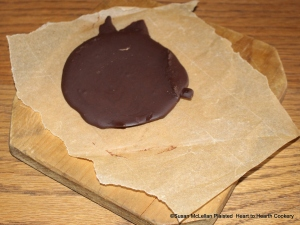 After the chocolate liquor has been removed from the heated metate, it solidifies into a chocolate cake. This chocolate cake with others was used to make the receipt (recipe)To make Chocolate with Water.