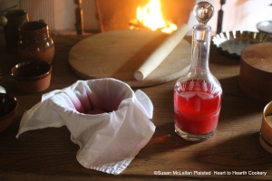 After the raspberries have been squeezed strongly for the receipt (recipe)To make Rasberry Wateraddsuch a Quantity of Water and Sugar as will make a pleasant Liguor.The raspberry water is in a reproduction hand blown glass decanter of Thomas Jefferson.
