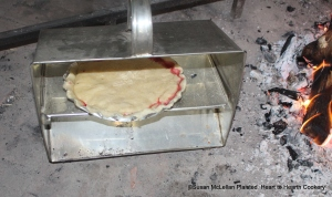 For the first baking of the receipt (recipe)To make a Rasberry Tarta tin baker was used. The tin baker is placed in front of the bed of embers and fire and the reflective heat bakes the tart. The tart must be rotated during this process for even baking.